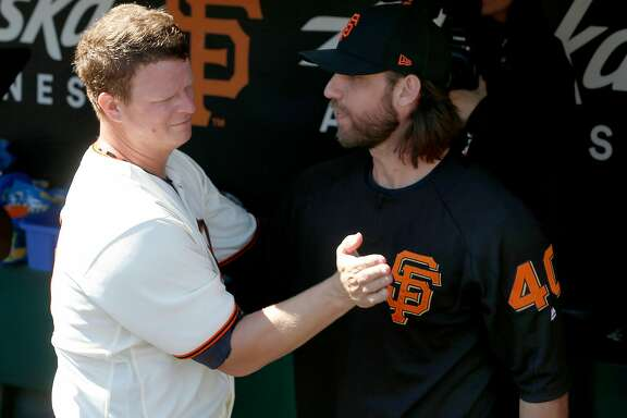 Pitcher Matt Cain embraces Madison Bumgarner after making his final Major League Baseball start in a Giants uniform against the San Diego Padres at AT&T Park before retiring after a 13-year career in San Francisco, Calif. on Saturday, Sept. 30, 2017.