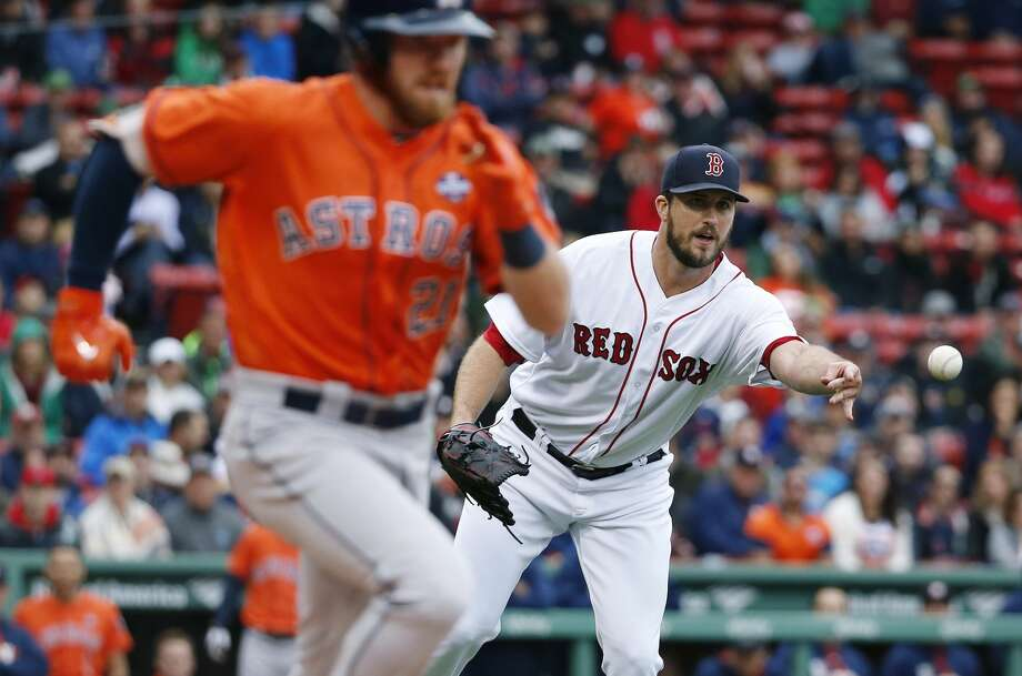 Boston Red Sox's Drew Pomeranz, right, tosses to first base on the single by Houston Astros' Derek Fisher (21) during the third inning of a baseball game in Boston, Saturday, Sept. 30, 2017. (AP Photo/Michael Dwyer) Photo: Michael Dwyer/Associated Press