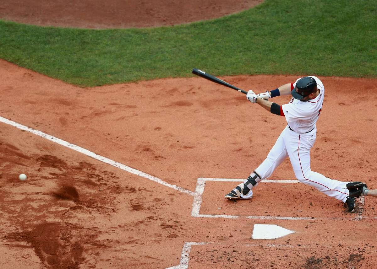 BOSTON, MA - SEPTEMBER 30: Mitch Moreland #18 of the Boston Red Sox hits a ground ball in the bottom of the second inning during the game against the Houston Astros at Fenway Park on September 30, 2017 in Boston, Massachusetts. (Photo by Omar Rawlings/Getty Images)