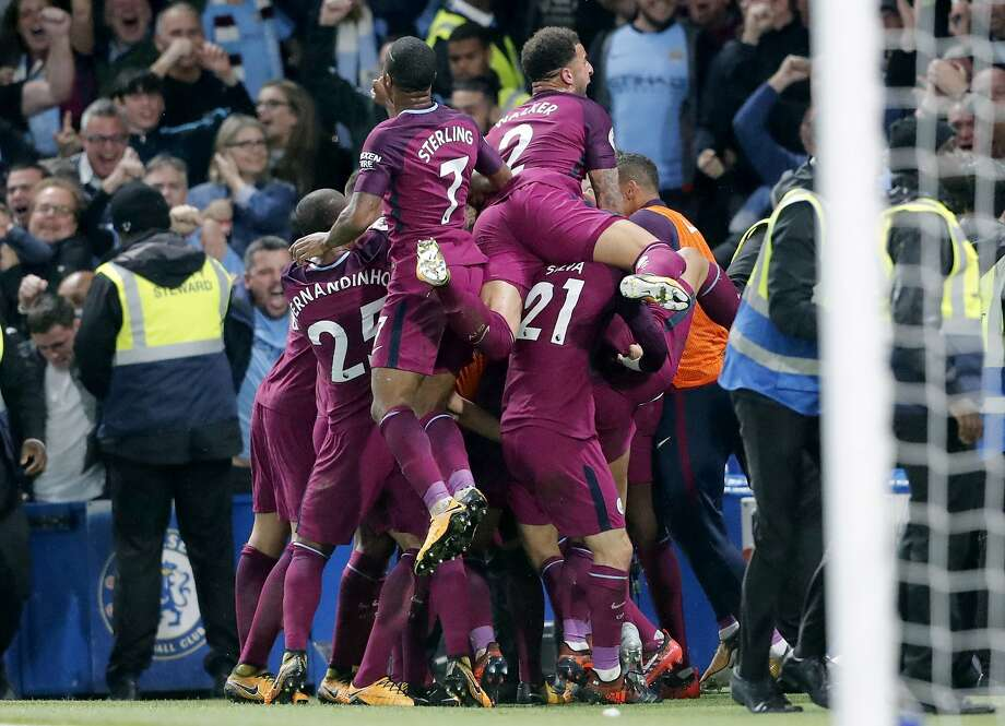 Somewhere under the pile is Manchester City's Kevin De Bruyne, who scored a spectacular goal that beat Chelsea 1-0. Photo: Frank Augstein, Associated Press
