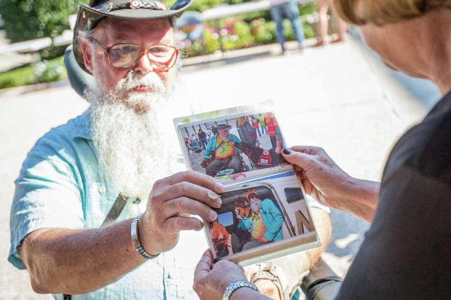 Conroe resident James VanWinkle shows a photo of his late service dog Roku to Rev. Mary Tumulty during the Blessing of the Animals on Saturday at First Methodist Conroe. Photo: Michael Minasi, Staff Photographer / © 2017 Houston Chronicle
