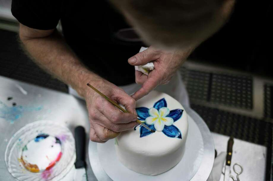 Jack Phillips works at Masterpiece Cakeshop, his bakery in Lakewood, Colo., Aug. 24, 2017. Phillips' refusal to bake a wedding cake to celebrate a same-sex marriage has led to a Supreme Court showdown that is likely to turn on the vote of Justice Anthony Kennedy, who is simultaneously the court''s most prominent defender of gay rights and its most ardent supporter of free speech. (Nick Cote/The New York Times) Photo: NICK COTE, STR / NYTNS