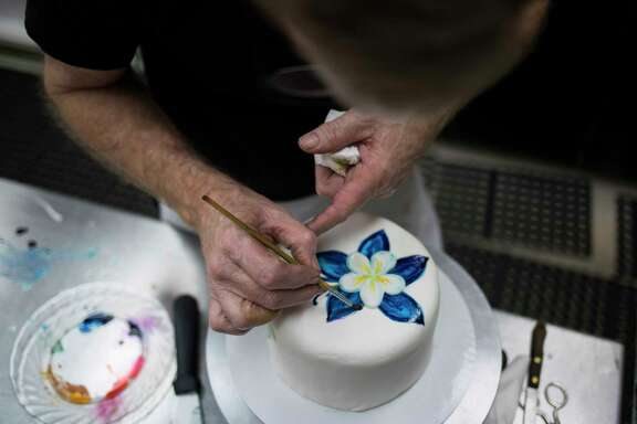 Jack Phillips works at Masterpiece Cakeshop, his bakery in Lakewood, Colo., Aug. 24, 2017. Phillips' refusal to bake a wedding cake to celebrate a same-sex marriage has led to a Supreme Court showdown that is likely to turn on the vote of Justice Anthony Kennedy, who is simultaneously the court's most prominent defender of gay rights and its most ardent supporter of free speech. (Nick Cote/The New York Times)