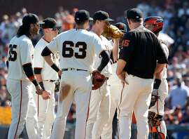 Infielders and manager Bruce Bochy gather for a conference on the mound with pitcher Matt Cain in the top of the 5th inning of his final Major League Baseball start in a Giants uniform against the San Diego Padres at AT&T Park before retiring after a 13-year career in San Francisco, Calif. on Saturday, Sept. 30, 2017.