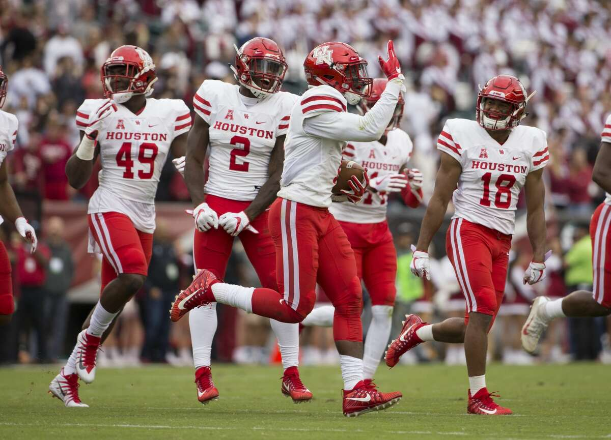 PHILADELPHIA, PA - SEPTEMBER 30: Garrett Davis #1 of the Houston Cougars celebrates with David Anenih #49, Khalil Williams #2, and Alexander Myres #18 after intercepting a pass in the second quarter against the Temple Owls at Lincoln Financial Field on September 30, 2017 in Philadelphia, Pennsylvania. (Photo by Mitchell Leff/Getty Images)