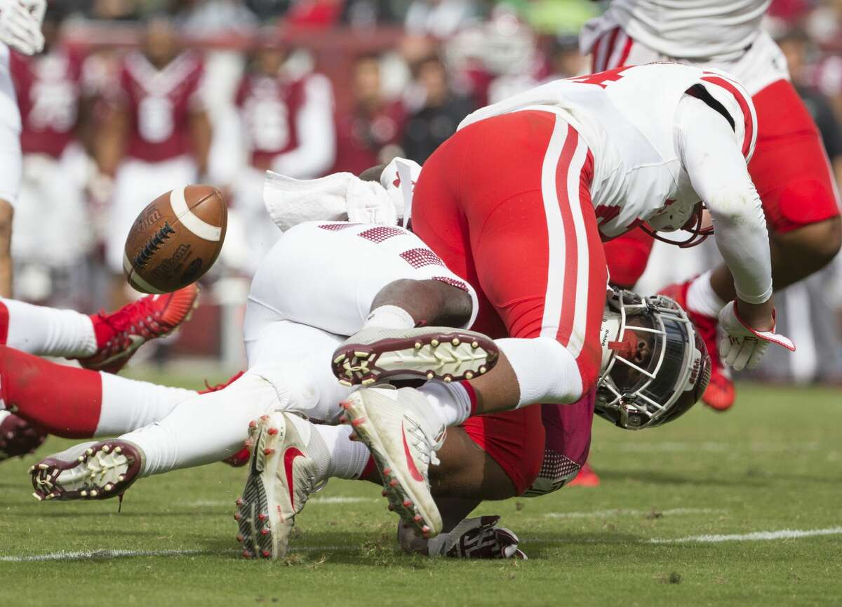 PHILADELPHIA, PA - SEPTEMBER 30: Jeremy Winchester #24 of the Houston Cougars forces a fumble against David Hood #24 of the Temple Owls in the third quarter at Lincoln Financial Field on September 30, 2017 in Philadelphia, Pennsylvania. The Houston Cougars defeated the Temple Owls 20-13. (Photo by Mitchell Leff/Getty Images)