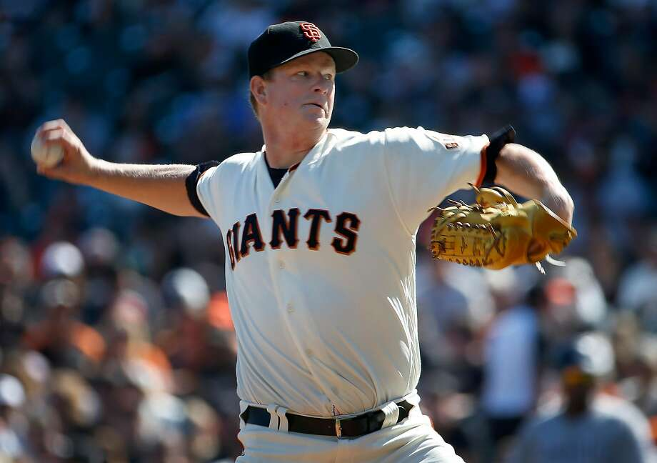 Pitcher Matt Cain delivers a pitch in his final Major League Baseball start in a Giants uniform against the San Diego Padres at AT&T Park before retiring after a 13-year career in San Francisco, Calif. on Saturday, Sept. 30, 2017. Photo: Paul Chinn, The Chronicle