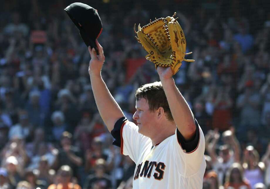 Pitcher Matt Cain raises his arms when he comes out of the game in the 5th inning after making his final Major League Baseball start in a Giants uniform against the San Diego Padres at AT&T Park before retiring after a 13-year career in San Francisco, Calif. on Saturday, Sept. 30, 2017. Photo: Paul Chinn / The Chronicle / ONLINE_YES