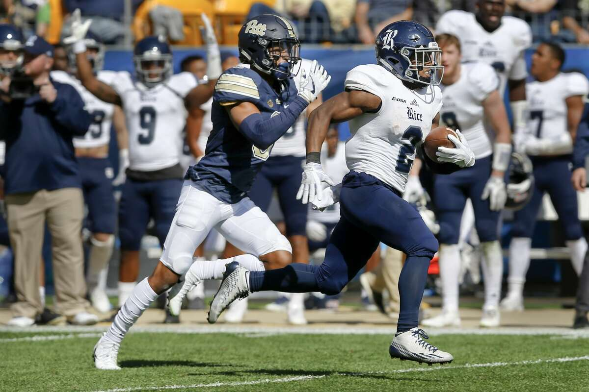 Rice running back Austin Walter (2) runs away from Pittsburgh defensive back Damar Hamlin (3) on his way to a touchdown after making a catch in the second half of an NCAA college football game, Saturday, Sept. 30, 2017, in Pittsburgh. Pittsburgh won 42-10. (AP Photo/Keith Srakocic)