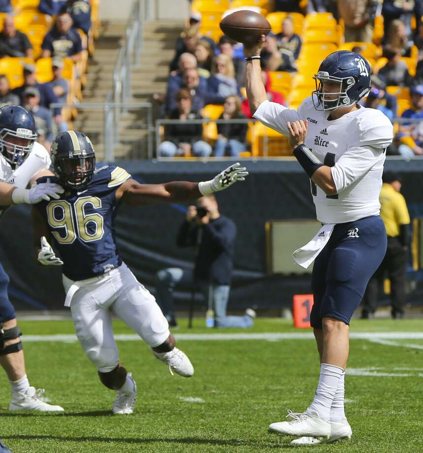 Rice quarterback Jackson Tyner (14) passes as he is pressured by Pittsburgh defensive lineman Allen Edwards (96) in the second quarter of an NCAA college football game, Saturday, Sept. 30, 2017, in Pittsburgh. (AP Photo/Keith Srakocic) Photo: Keith Srakocic/Associated Press