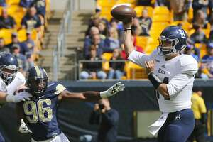 Rice quarterback Jackson Tyner (14) passes as he is pressured by Pittsburgh defensive lineman Allen Edwards (96) in the second quarter of an NCAA college football game, Saturday, Sept. 30, 2017, in Pittsburgh. (AP Photo/Keith Srakocic)