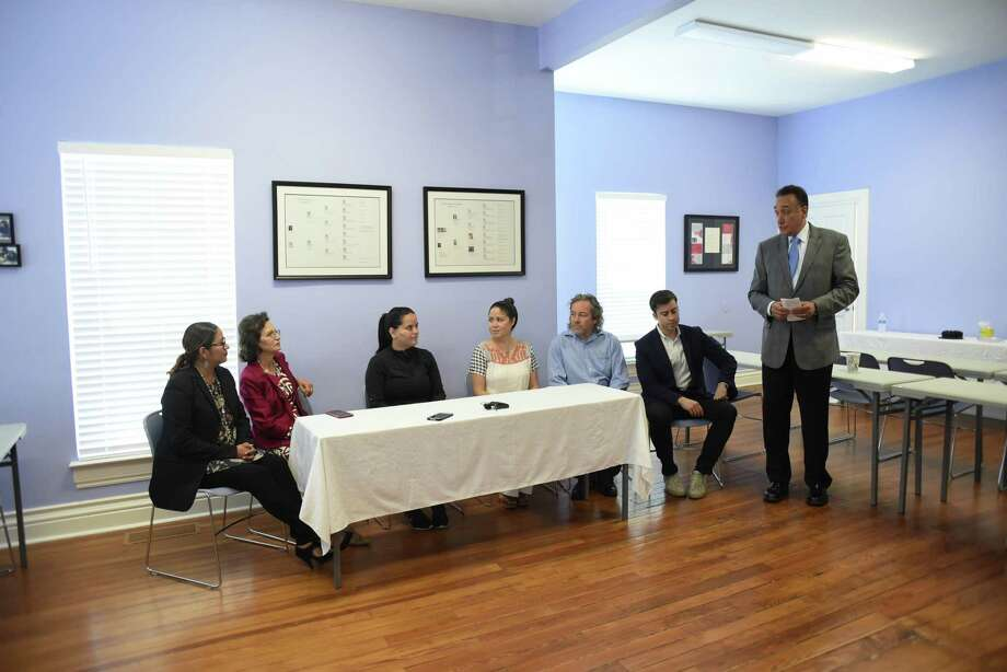 Businessman and politician Henry Cisneros leads a discussion about relief for Puerto Rico during a news conference at the Carol Burnett Center on Saturday. Seated at the table are Verlyn Maldonado (from left), executive director of American Sunrise; Cisneros' wife, Mary Alice; Francheska Rios of Puerto Rico Rises-San Antonio; Liliana and Chris Mackenzie; and Alberto Altamirano of Cityflag. Cisneros is helping to facilitate relief help for Puerto Rico, which has suffered severe damage from hurricanes. Photo: Billy Calzada /San Antonio Express-News