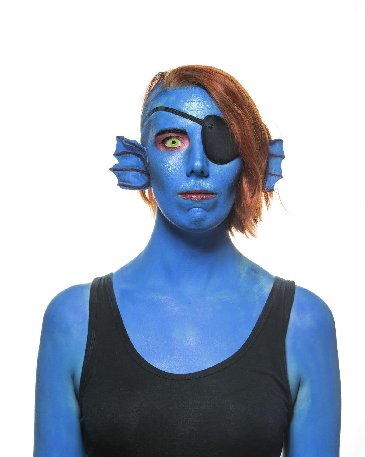 Kathryn Lingel poses for a portrait as Undyne from Undertale, a video game, during GeekGirlCon at the Washington State Convention Center on Saturday, Sept. 30, 2017.