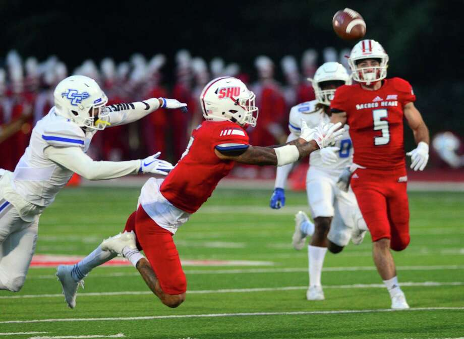 Sacred Heart University's Byron Barney tries to complete a pass sent to him during college football action against Central Connecticut in Fairfield, Conn., on Saturday Sept. 30, 2017. Photo: Christian Abraham / Hearst Connecticut Media / Connecticut Post