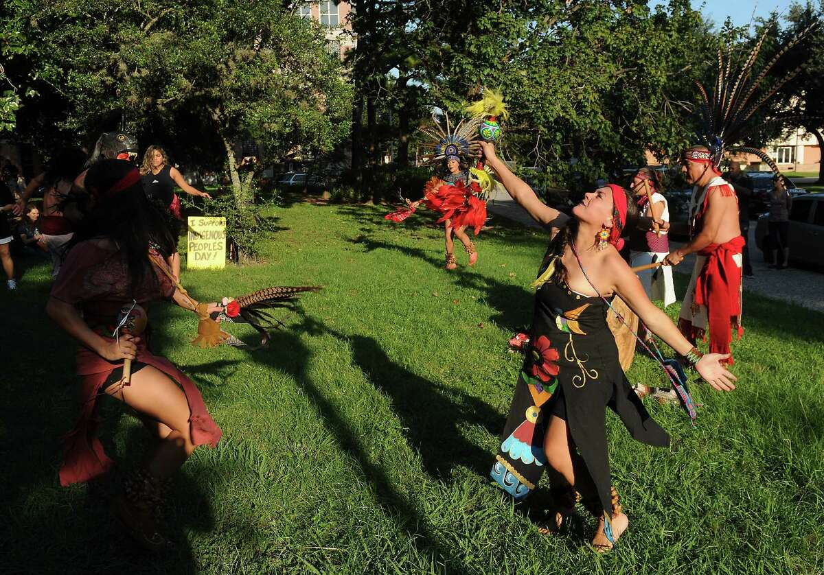 Members of Danza Azteca Taxca Yoloztl perform during a protest and march to recognize Indigenous Peoples day at Bell Park Saturday Sept. 30, 2017.(Dave Rossman Photo)