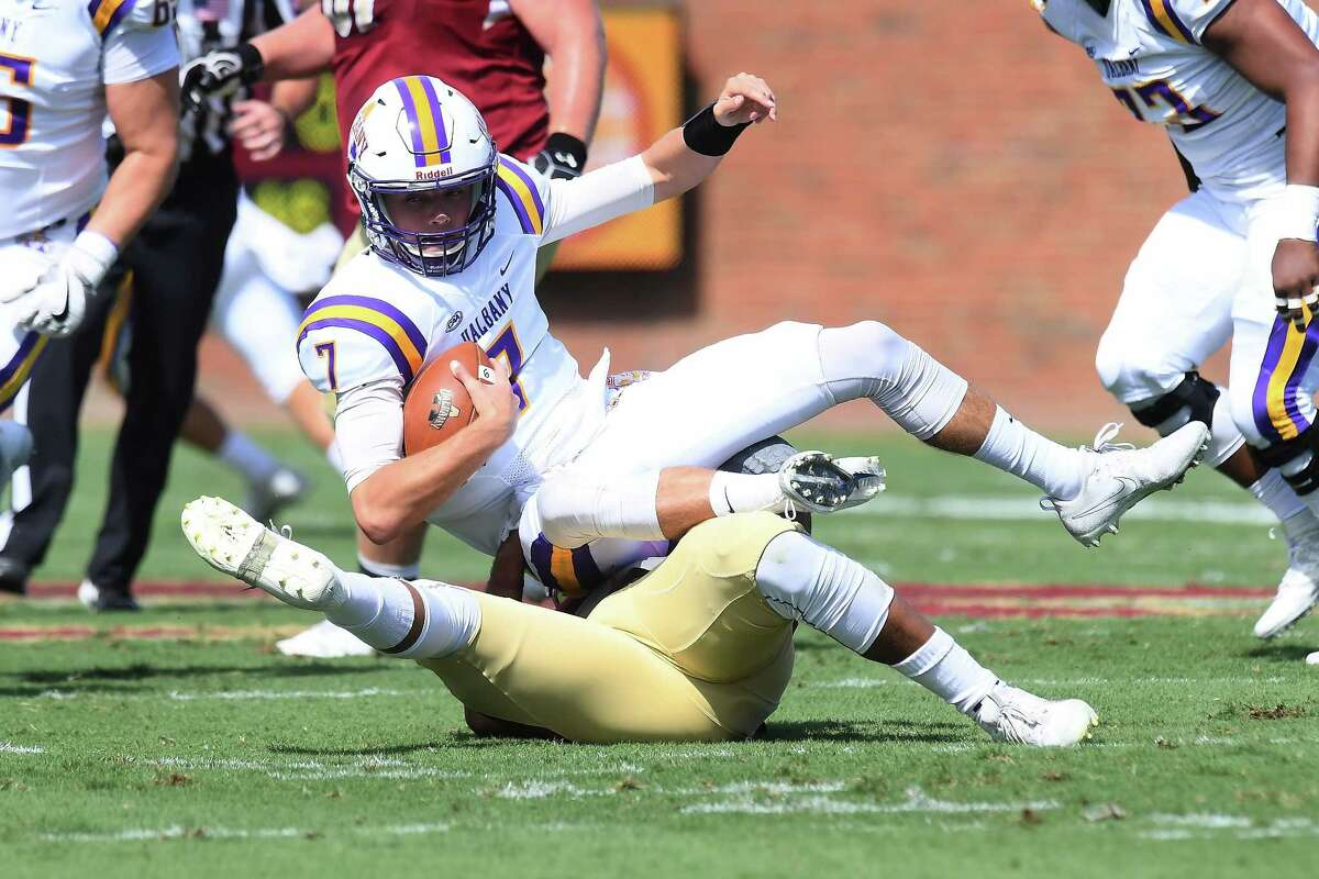 Dondre Howell of Elon sacks UAlbany's Will Brunson early in the first quarter of their Colonial Athletic Association game at Rhodes Stadium on Saturday, Sept. 30, 2017 in Elon, N.C. (Tim Cowie / Courtesy of Elon)