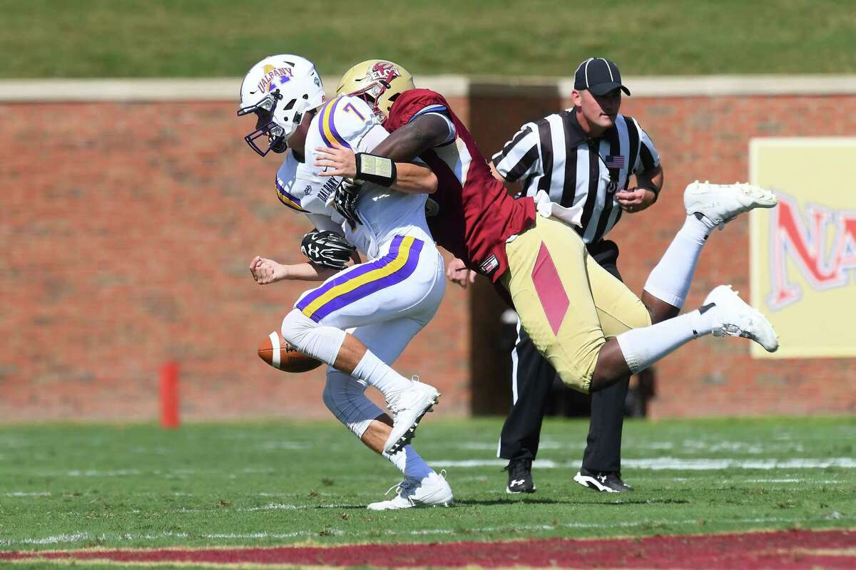 UAlbany's Will Brunson is sacked by Elon's Marcus Willoughby and fumbles the ball early in the first quarter of their Colonial Athletic Association game at Rhodes Stadium on Saturday, Sept. 30, 2017 in Elon, N.C. (Tim Cowie / Courtesy of Elon)