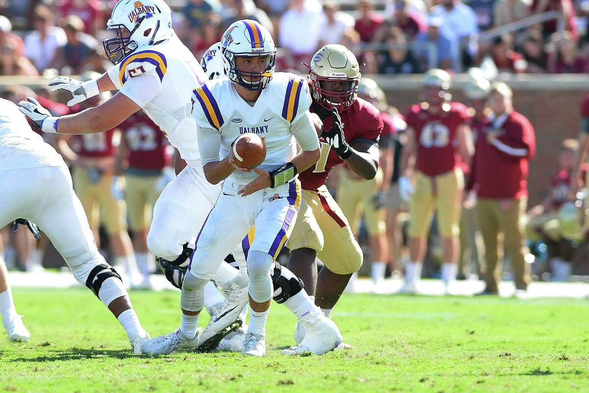 UAlbany quarterback Will Brunson looks to hand off the ball early in the second quarter of their Colonial Athletic Association game at Rhodes Stadium on Saturday, Sept. 30, 2017 in Elon, N.C. (Tim Cowie / Courtesy of Elon)
