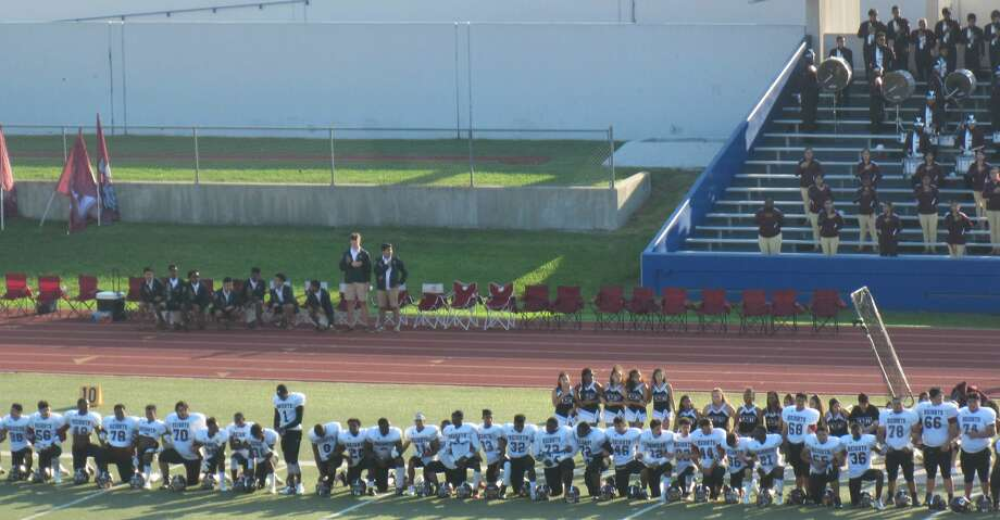 Heights HS football players kneeling during the national anthem on Sept. 30, 2017 prior to their game against Sam Houston. Photo: Darrell Addison