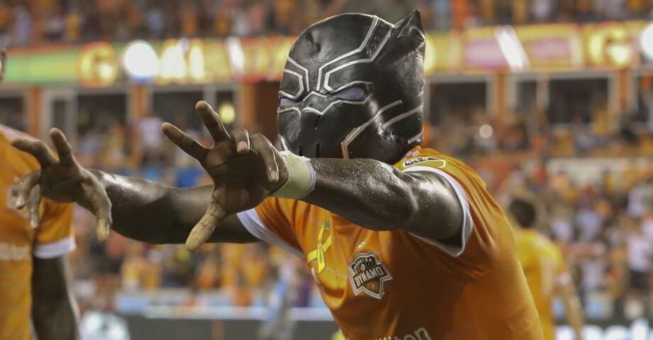 Dynamo forward Alberth Elis (17) wears a Black Panther mask while celebrating a goal in October. This week he will take 80 middle school students to see the Black Panther movie that inspired this celebration. Photo: Yi-Chin Lee/Houston Chronicle