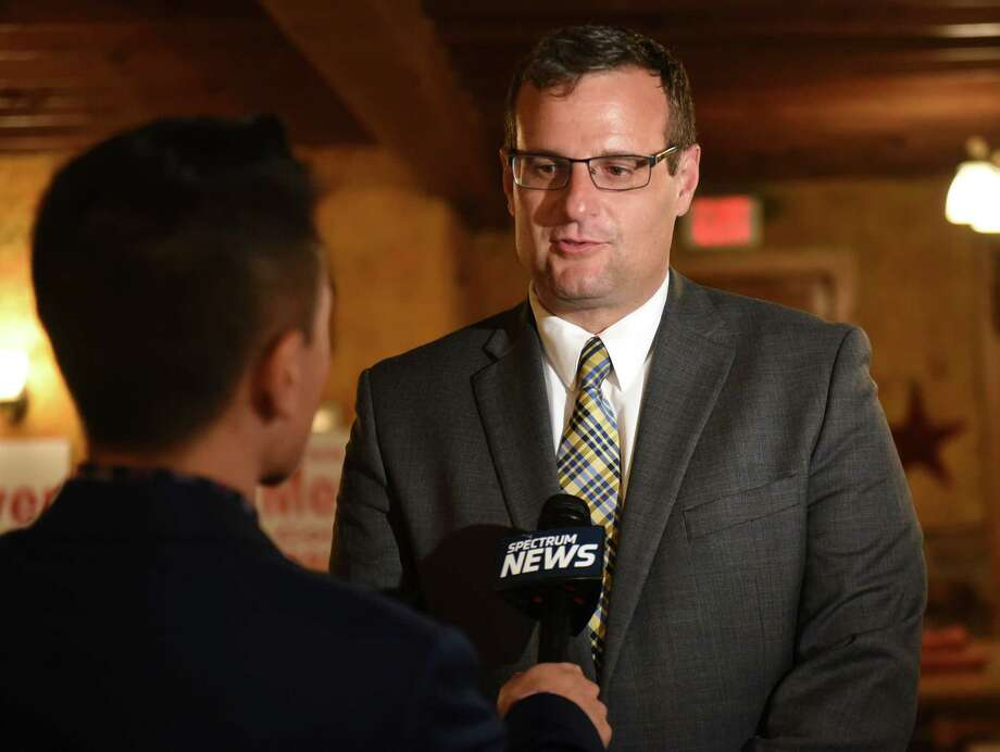 Deputy County Executive Christopher Meyer speaks to a reporter while waiting to hear the results of the Republican primary race for county executive at Brunswick BBQ and Brew on Tuesday Sept. 12, 2017 in Brunswick, N.Y.  (Lori Van Buren / Times Union) Photo: Lori Van Buren / 40041521A