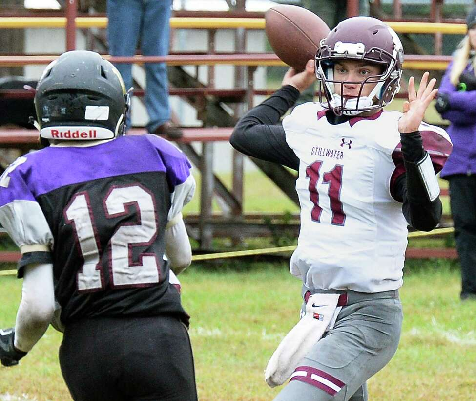 Stillwater QB #11 Sean Kane gets off a pass as Holy Trinity's #12 Nacier Hundley closes in during Saturday's game Sept. 30, 2017 in Schenectady,NY. (John Carl D'Annibale / Times Union)