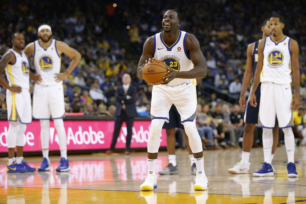 Golden State Warriors forward Draymond Green (23) shoots a free throw during the first half of an NBA preseason basketball game against the Denver Nuggets at the Oracle Arena on Saturday, Sept. 30, 2017.