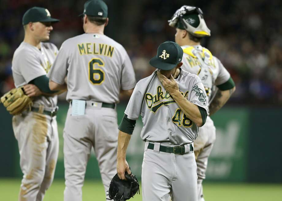 Oakland Athletics starting pitcher Daniel Gossett (48) walks to the dugout after he was pulled from the game by manager Bob Melvin (6) during the second inning of a baseball game against the Texas Rangers in Arlington, Texas, Saturday, Sept. 30, 2017. (AP Photo/LM Otero) Photo: LM Otero, Associated Press