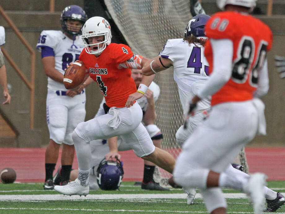 UTPB quarterback Kameron Mathis (4) rushes for a gain against Tarleton State in a Lone Star Conference game, Saturday, Sept. 30 at Ratliff Stadium in Odessa. Jacob Ford/Odessa American.