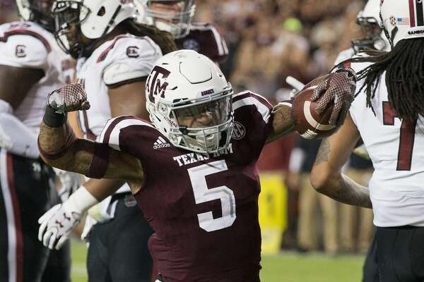 COLLEGE STATION, TX - SEPTEMBER 30:  Trayveon Williams #5 of the Texas A&M Aggies celebrates his score in the second quarter against the South Carolina Gamecocks at Kyle Field on September 30, 2017 in College Station, Texas.  (Photo by Bob Levey/Getty Images)