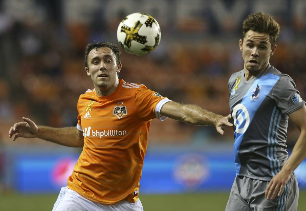 Houston Dynamo midfielder Andrew Wenger (11) and Minnesota United midfielder Sam Nicholson (28) react to a long pass toward their way during the second half of a Major League Soccer game at BBVA Compass Stadiuym Saturday, Sept. 30, 2017, in Houston. Houston Dynamo defeated Minnesota United 2-1. ( Yi-Chin Lee / Houston Chronicle )