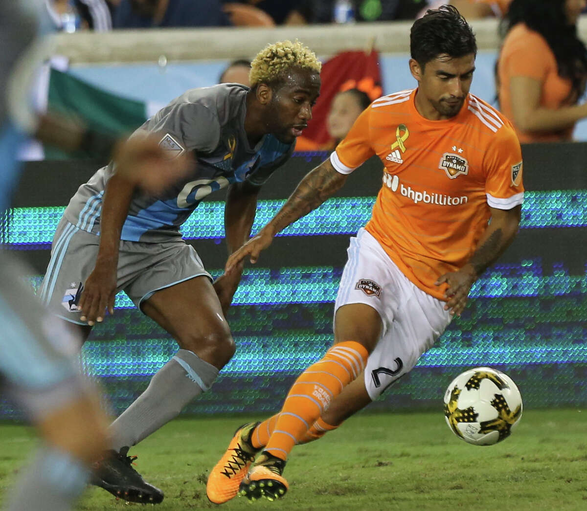 Houston Dynamo defender A. J. DeLaGarza (20) gets the ball away from Minnesota United midfielder Kevin Molino (18) while defensing Molino during the first half of a Major League Soccer game at BBVA Compass Stadiuym Saturday, Sept. 30, 2017, in Houston. ( Yi-Chin Lee / Houston Chronicle )