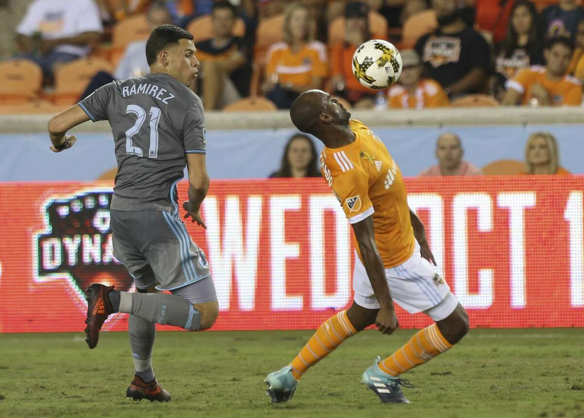 Houston Dynamo defender Adolfo Machado (3) uses his body to get the ball away from Minnesota United forward Christian Ramirez (21) during the first half of a Major League Soccer game at BBVA Compass Stadiuym Saturday, Sept. 30, 2017, in Houston. ( Yi-Chin Lee / Houston Chronicle )
