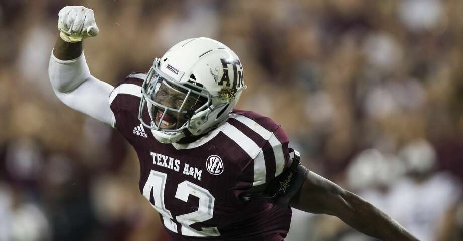 Texas A&M linebacker Otaro Alaka (42) reacts after sacking South Carolina quarterback Jake Bentley during the fourth quarter of an NCAA college football game Saturday, Sept. 30, 2017, in College Station, Texas. (AP Photo/Sam Craft) Photo: Sam Craft/Associated Press