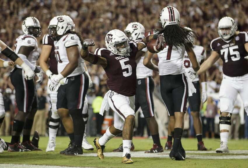 Texas A&M running back Trayveon Williams (5) reacts after scoring a touchdown during the first quarter of an NCAA college football game against South Carolina, Saturday, Sept. 30, 2017, in College Station, Texas. (AP Photo/Sam Craft)