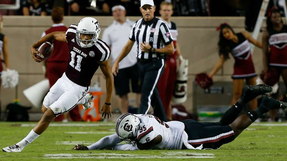 COLLEGE STATION, TX - SEPTEMBER 30:  Kellen Mond #11 of the Texas A&M Aggies avoids the tackle attempt of Dante Sawyer #95 of the South Carolina Gamecocks in the third quarter at Kyle Field on September 30, 2017 in College Station, Texas.  (Photo by Bob Levey/Getty Images) Photo: Bob Levey/Getty Images