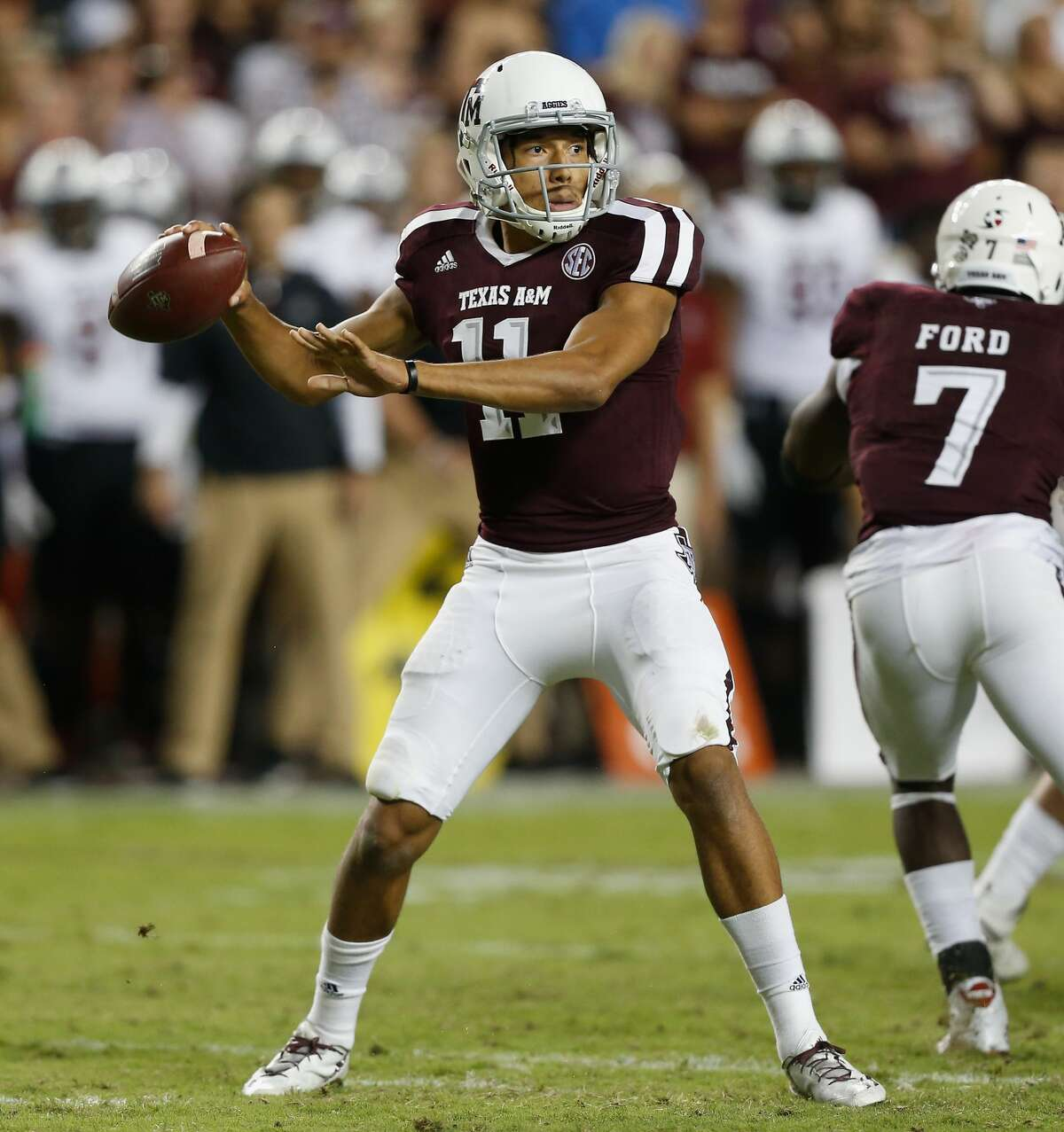 COLLEGE STATION, TX - SEPTEMBER 30: Kellen Mond #11 of the Texas A&M Aggies looks for a receiver against the South Carolina Gamecocks at Kyle Field on September 30, 2017 in College Station, Texas. (Photo by Bob Levey/Getty Images)