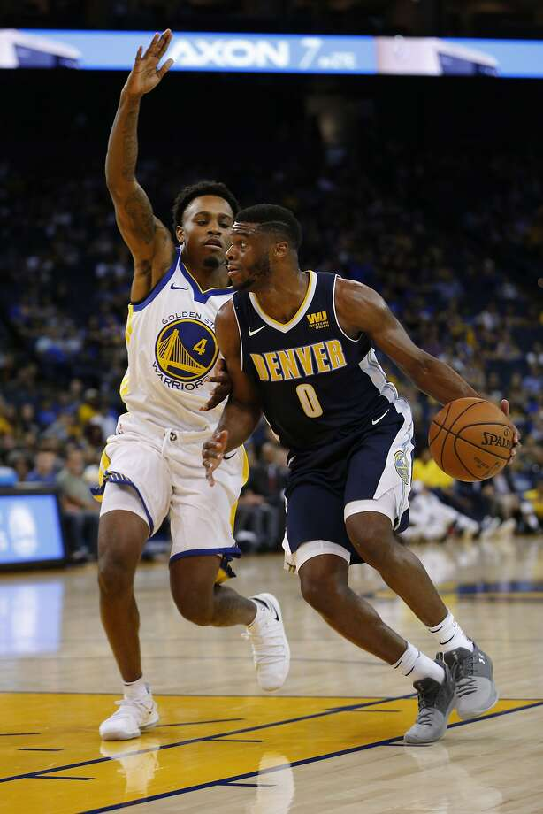 Golden State Warriors Antonius Cleveland (4) defends Denver Nuggets guard Emmanuel Mudiay (0) during the second half of an NBA Preseason basketball game between the Golden State Warriors and Denver Nuggets at the Oracle Arena on Saturday, Sept. 30, 2017, in Oakland, Calif. The Denver Nuggets won the game with a final score of 108-102. Photo: Santiago Mejia, The Chronicle