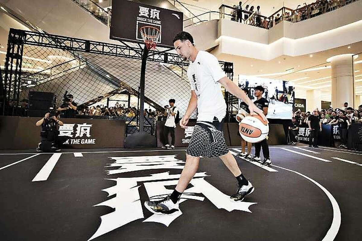 Warriors guard Klay Thompson dribbles the ball at a recent promotional event in China.