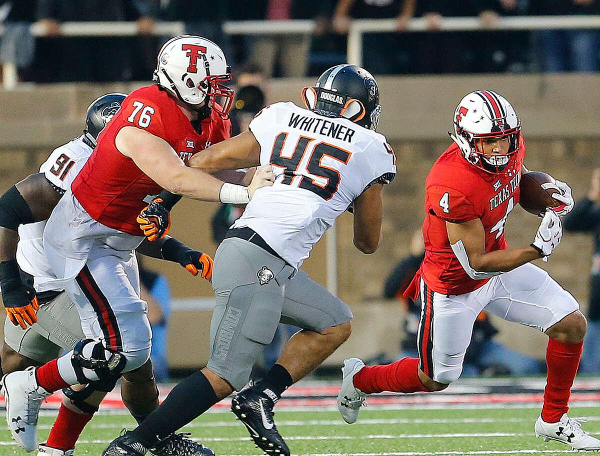 Texas Tech running back Justin Stockton (4) turns the corner against the OSU defense Saturday night at Jones AT&T Stadium. (Photo by Wade H. Clay)