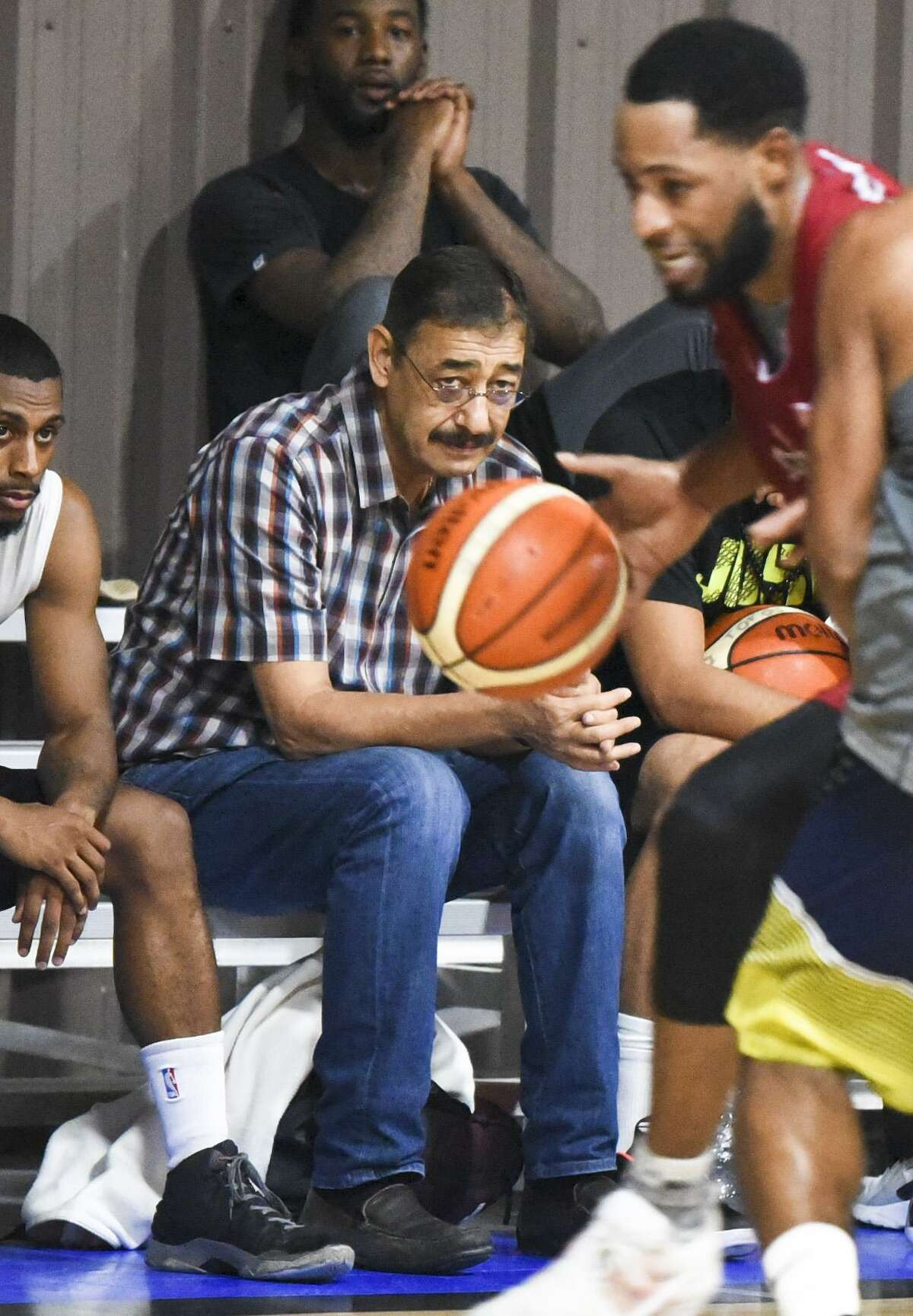 Toros de Nuevo Laredo owner Jose Hernandez Villegas watches players from around the nation try out Saturday at the Laredo Athletic Complex.
