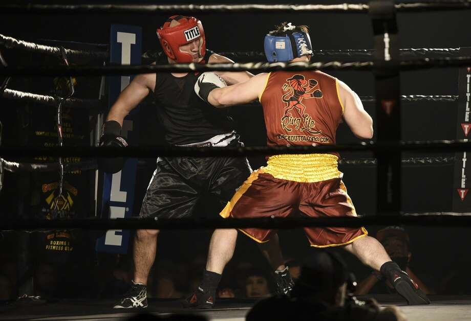 Eric Navarette, left, faced off in a bout against Javier Guzman, representing the Webb County District Attorney's Office during the Guns-N-Hoses Round 9 boxing event on Saturday night at the Casa Blanca Ballroom. Photo: Danny Zaragoza /Laredo Morning Times