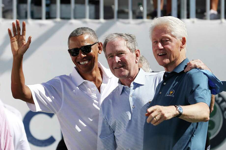 *** BESTPIX *** JERSEY CITY, NJ - SEPTEMBER 28:  (L-R) Former U.S. Presidents Barack Obama, George W. Bush and Bill Clinton attend the trophy presentation prior to Thursday foursome matches of the Presidents Cup at Liberty National Golf Club on September 28, 2017 in Jersey City, New Jersey.  (Photo by Rob Carr/Getty Images) Photo: Rob Carr / 2017 Getty Images