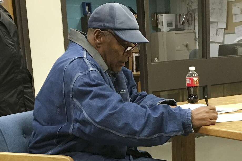 Former football legend O.J. Simpson signs documents at the Lovelock Correctional Center, Saturday, Sept. 30, 2017, in Lovelock, Nev. Simpson was released from the Lovelock Correctional Center in northern Nevada early Sunday, Oct. 1, 2017. (Brooke Keast/Nevada Department of Corrections via AP) Photo: Brooke Keast, Associated Press