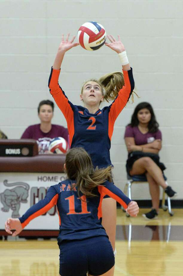 Morgan Janda (2) of Seven Lakes sets a ball in the first set of a high school volleyball game between the Seven Lakes Spartans and the Clements Rangers during the 2017 Cy-Fair ISD/Katy ISD Classic on August 10, 2017 at Cinco Ranch High School, Katy, TX. Photo: Craig Moseley, Staff / ©2017 Houston Chronicle