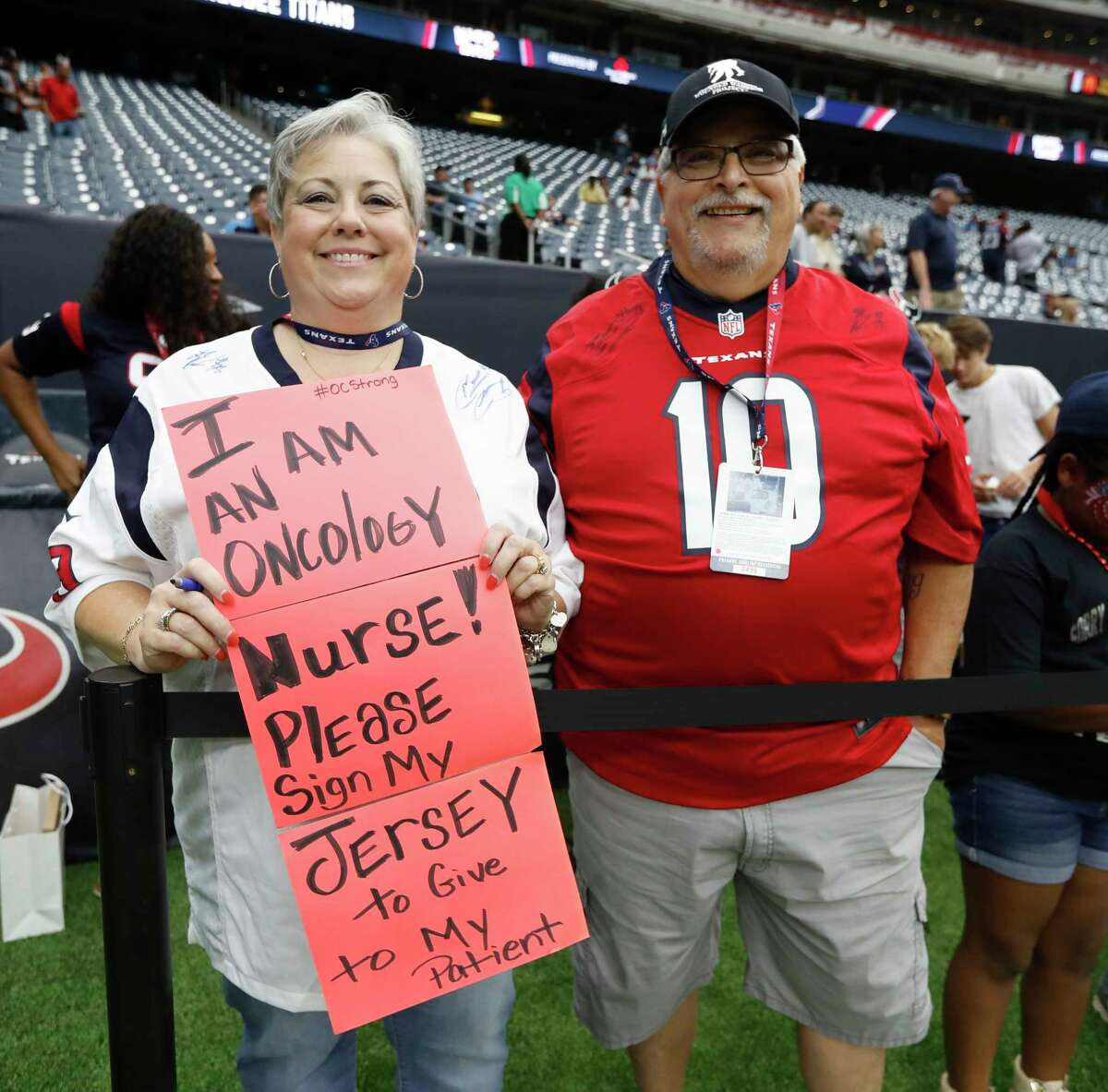 Fans on the field before the start of an NFL football game at NRG Stadium, Sunday, Oct. 1, 2017, in Houston.