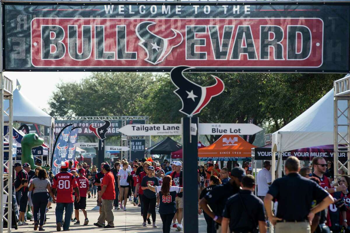 Houston Texans fans walk around outside the stadium while tailgating before an NFL football game against the Tennessee Titans at NRG Stadium on Sunday, Oct. 1, 2017, in Houston.
