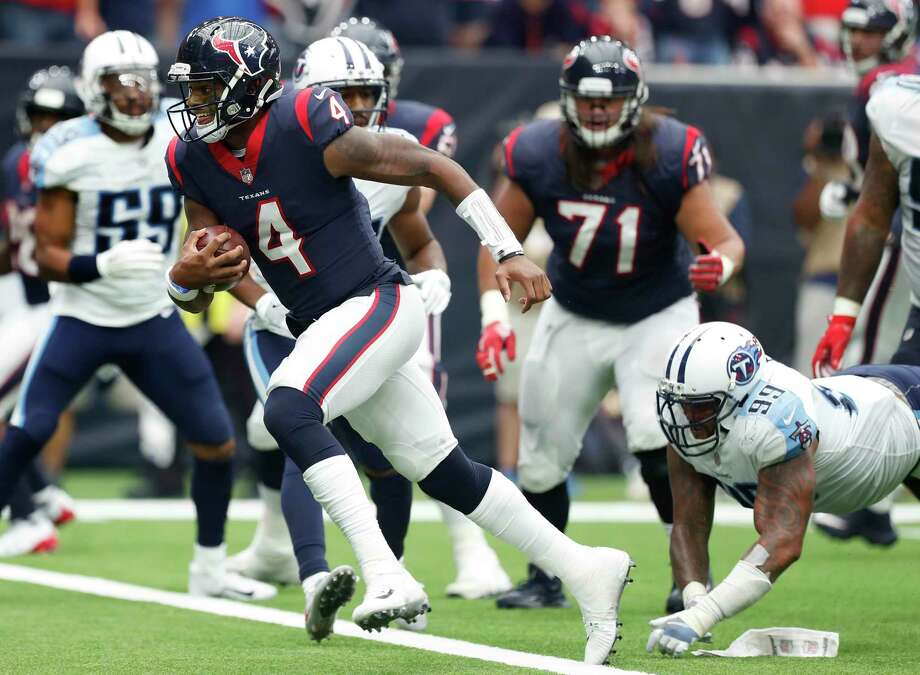 Houston Texans quarterback Deshaun Watson (4) runs p-ast Tennessee Titans defensive end Jurrell Casey (99) for a 1-yard touchdown run during the second quarter of an NFL football game at NRG Stadium on Sunday, Oct. 1, 2017, in Houston. Photo: Brett Coomer, Houston Chronicle / © 2017 Houston Chronicle