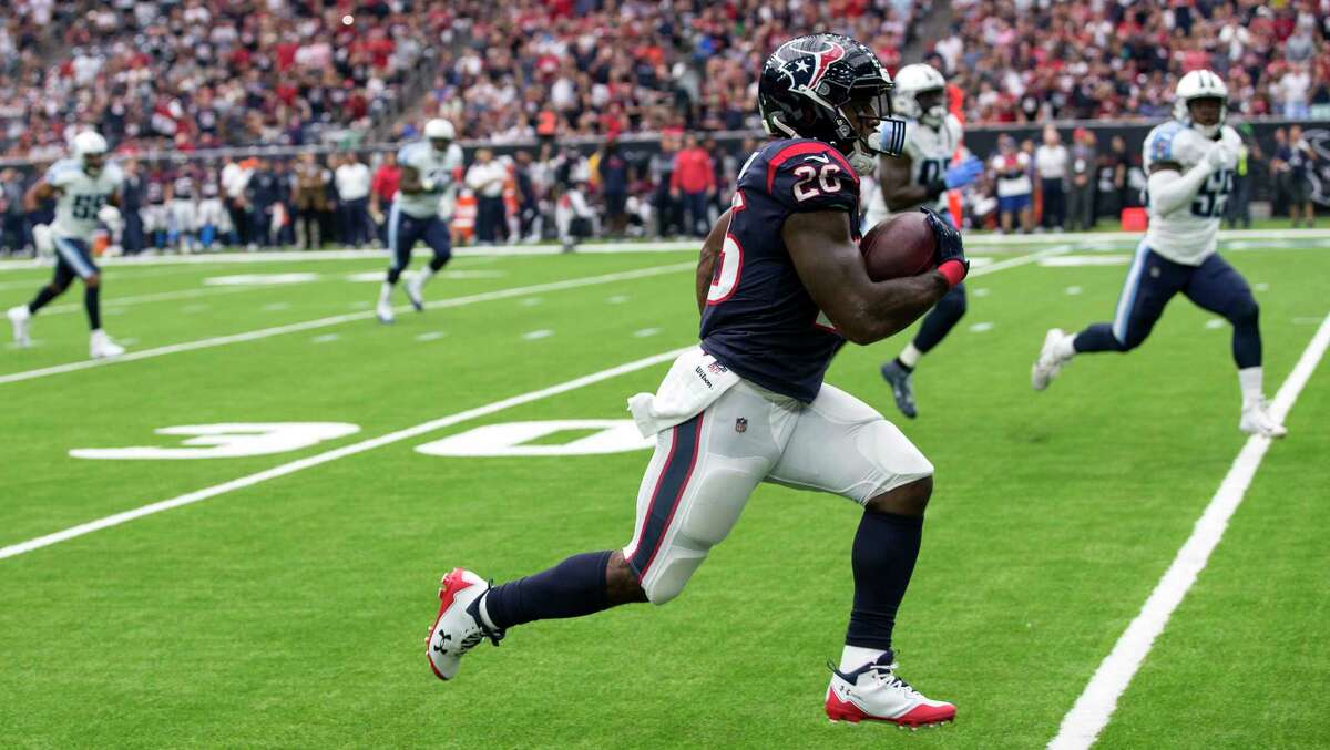 Houston Texans running back Lamar Miller (26) races downfield for a first down reception against the Tennessee Titans during the first quarter of an NFL football game at NRG Stadium on Sunday, Oct. 1, 2017, in Houston.