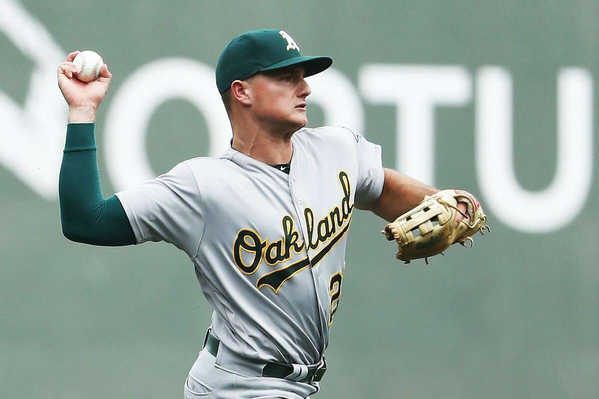 BOSTON, MA - SEPTEMBER 14: Matt Chapman #26 of the Oakland Athletics throws to first to force out Dustin Pedroia #15 of the Boston Red Sox during the first inning at Fenway Park on September 14, 2017 in Boston, Massachusetts. (Photo by Maddie Meyer/Getty Images)